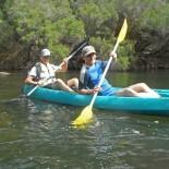 Brian and Nik relax in a tandem kayak