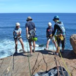 Dad and daughter abseiling